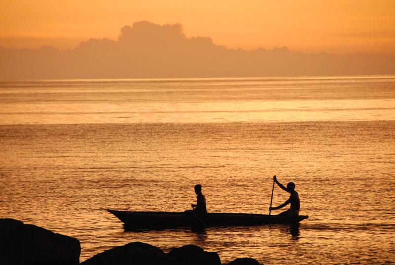 Dugout canoe at sunset, Lake Malawi.