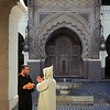 Men at mosque, old city, Fez, Morocco.