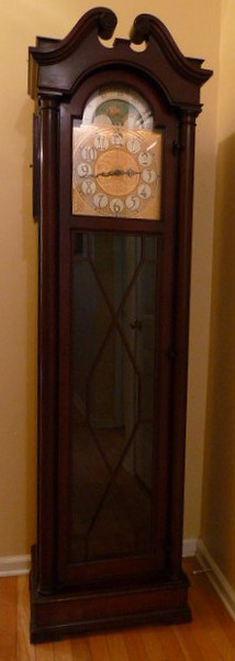 Grandfather clock with mechanical movement and electric Westminster chimes.