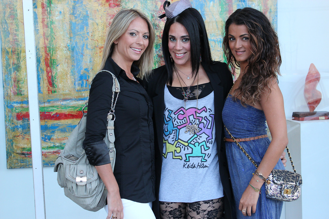 Celebrity TV personality GG and friends at Sona's art opening.