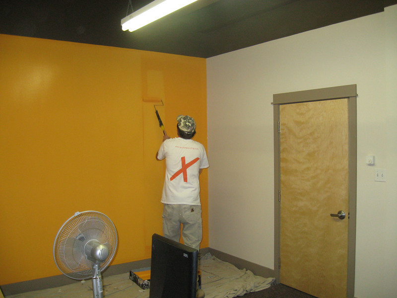 Moe, putting the finishing touches on an Orange wall for Spheric