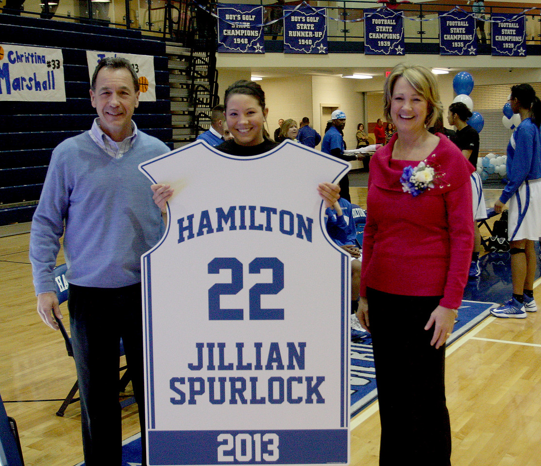 E.L. Hubbard photo<br /> Hamilton High senior Jillian Spurlock, center, and her parents, Greg and Cindi Spurlock, with the plaque that will hang in the HHS gym in honor of Jillian becoming the career scoring leader of the girls basketball team Monday, Feb. 4, 2013.