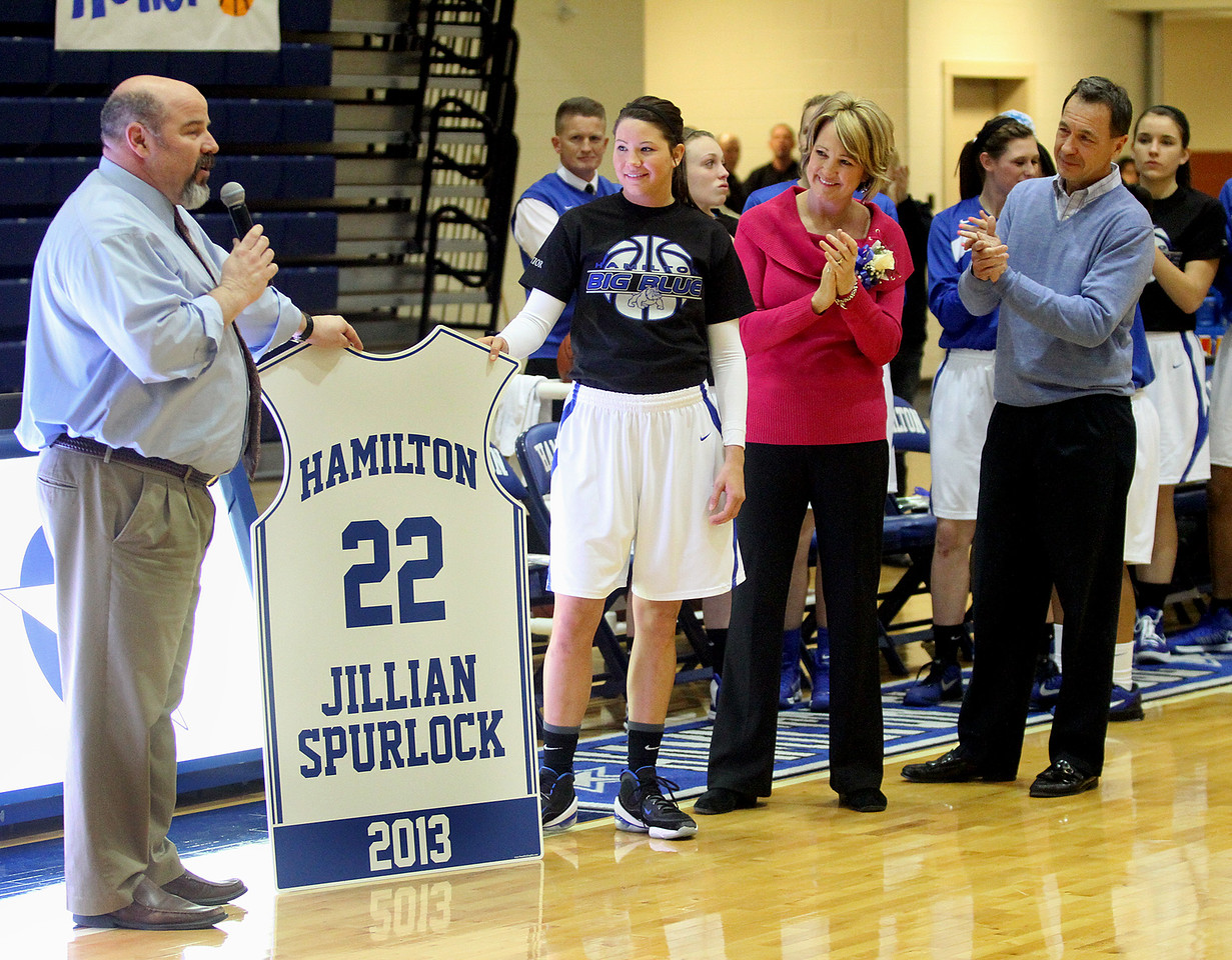 E.L. Hubbard photo<br /> Hamilton High senior Jillian Spurlock, center, and her parents, Cindi and Greg Spurlock, listen as Hamilton Athletic Director Michael Dellapina shows them the plaque that will hang in the gym in honor of Jillian becoming the school's career scoring leader during Senior Recognition Night at the school Monday, Feb. 4, 2013.