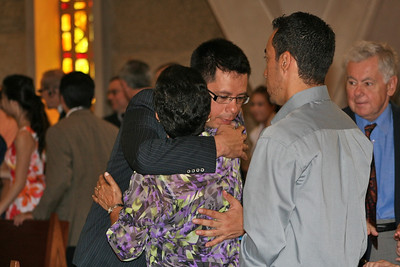 Frater Fernado hugs his mother during the sign of peace.