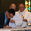 Fernando, now Frater Luis Fernando Orozco Cardona, SCJ, signs his vows.
