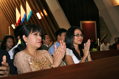 Joseph's family claps during the liturgy.