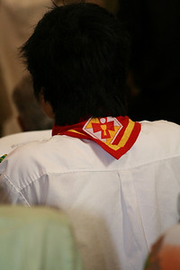 Among those at the ceremony were members of a Vietnamese youth group; the scarf –– featuring the symbols of the Eucharist –– is worn by the youth.