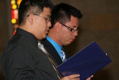 Joseph reads his profession of vows in both Vietnamese and English.