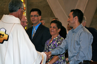 Fr. Cassidy greets Frater Fernando's family.