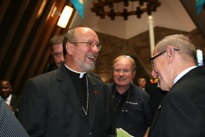 Fr. Byron Haaland laughs with Br. Pete Mankins.