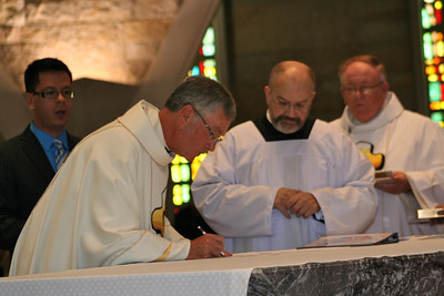 Fr. Tom Cassidy signs Frater Fernando's vow statement.