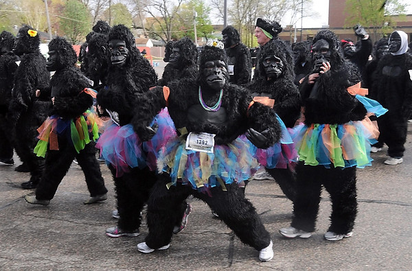 Runners in Saturday's Gorilla Run jazzed up their suits for the race.
