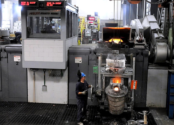 Dotson Company's new automated furnaces have allowed the company to automate some tasks and move others to climate controlled areas, such as the furnace's control room at left.