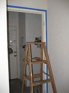 Taping room before painting.
