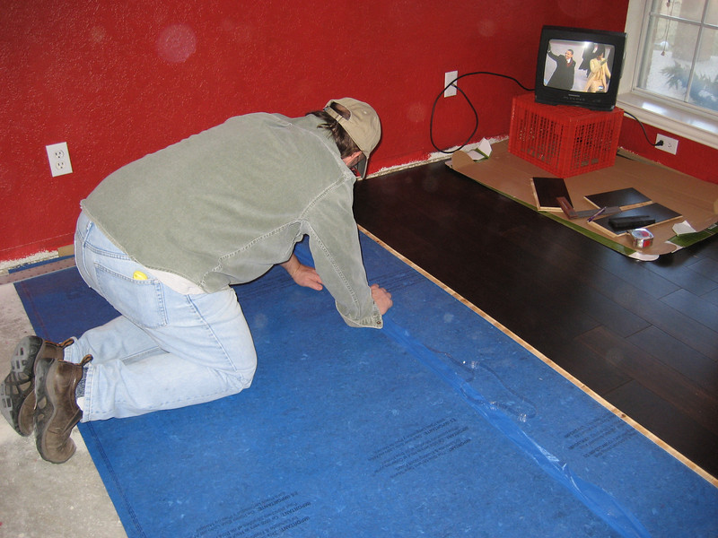 Attaching another row of underlayment.