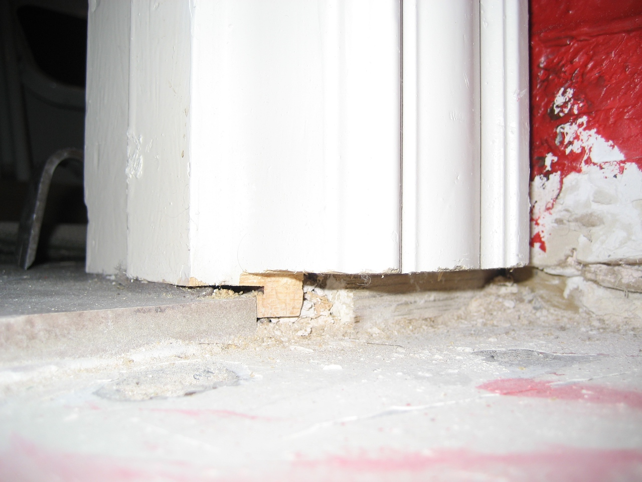 Door frame after it's been undercut so that the flooring will fit.