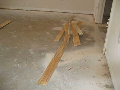 Baseboard removed, shows nails left in place.