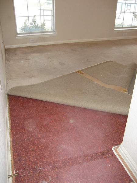 Removing carpet.