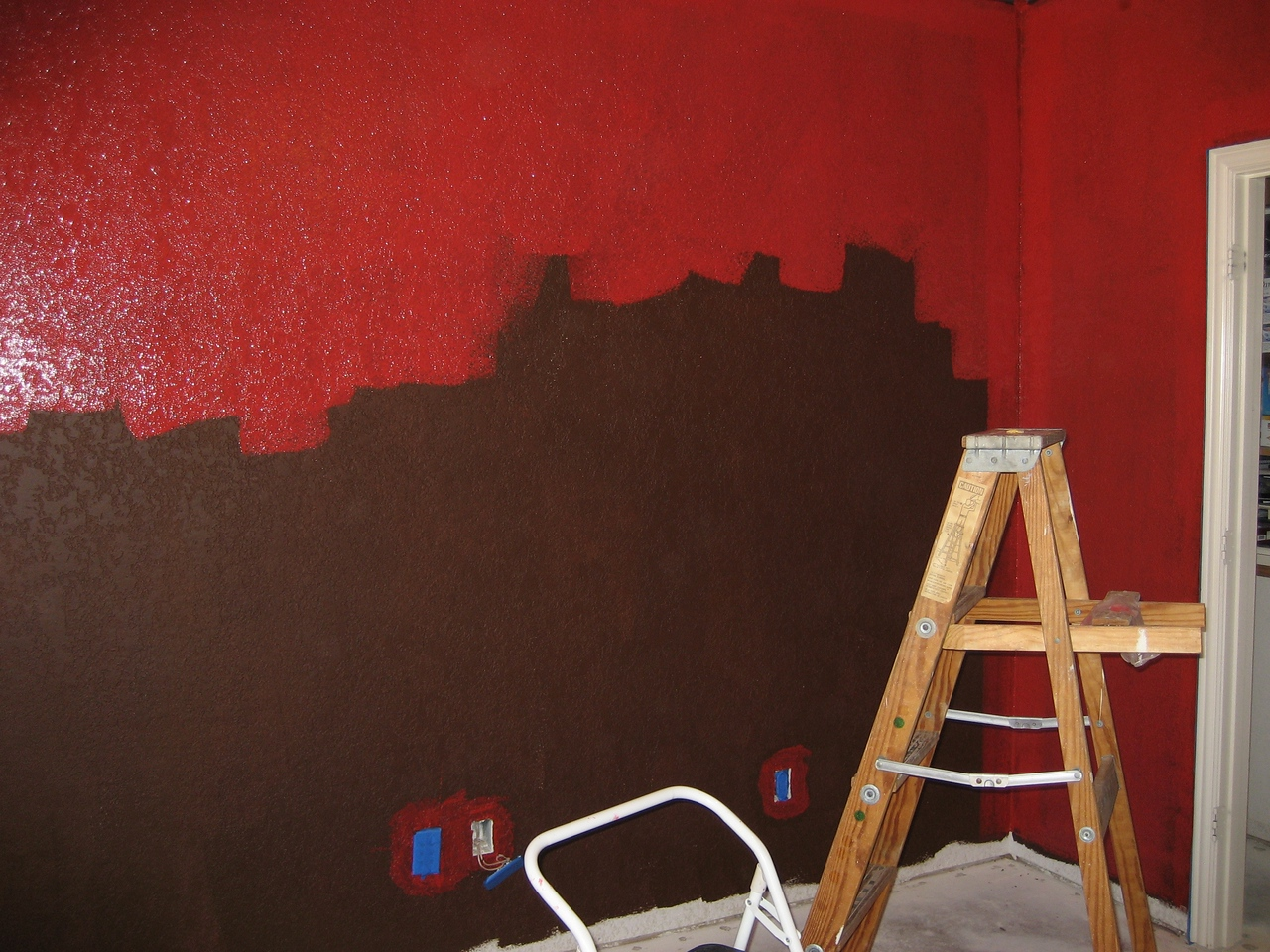 Putting red on. Took 3 coats, Eggshell Behr Daredevil.