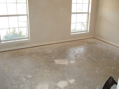 Room with carpet and pad removed.