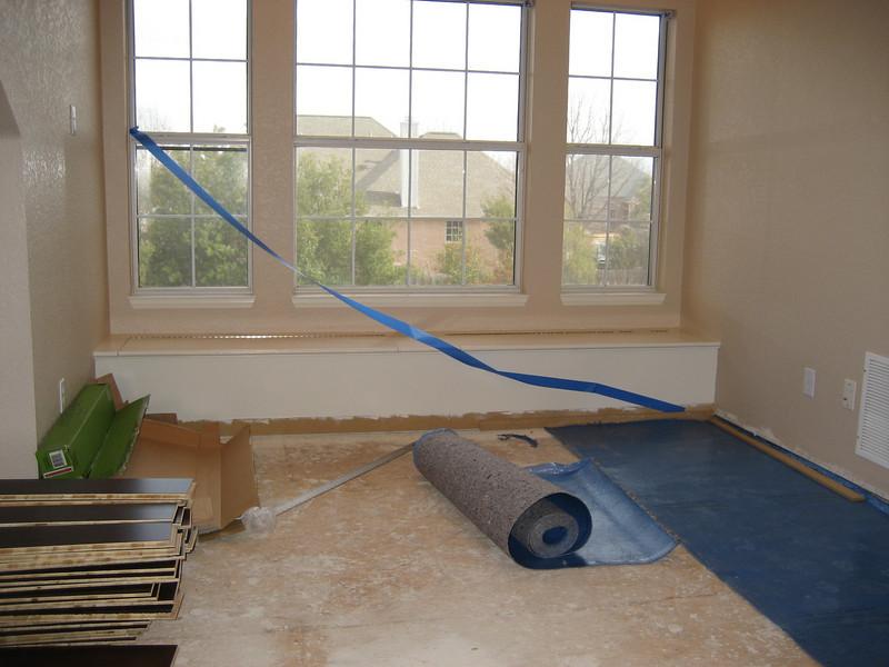 Laying floor in main room.