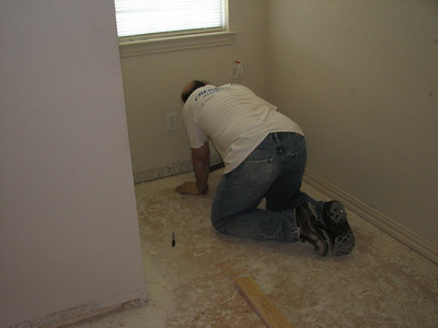 Me working on baseboard removal, note, no plumbers crack.