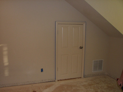 Baseboards removed, taped for painting