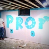 Cody Ruholl askes Asia Zumbahlen to prom by painting it on a wall.