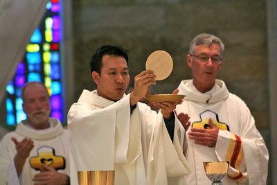 Fr Vien Nguyen with Frs. Ed Kilianski and Tom Cassidy in the background.
