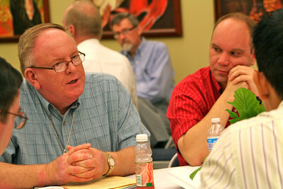 Dn. David Nagel talks while Fr. David Szatkowski looks on.