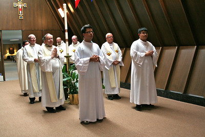 The novices –– Luis Fernando Orozco Cardona and Joseph Vu –– prepare to lead the procession for the installation Mass.