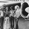 British rock band Led Zeppelin, (left - right): John Paul Jones, John Bonham (1948 - 1980), Jimmy Page and Robert Plant, pose in front of an airplane, 1970s. (Photo by Hulton Archive/Getty Images)