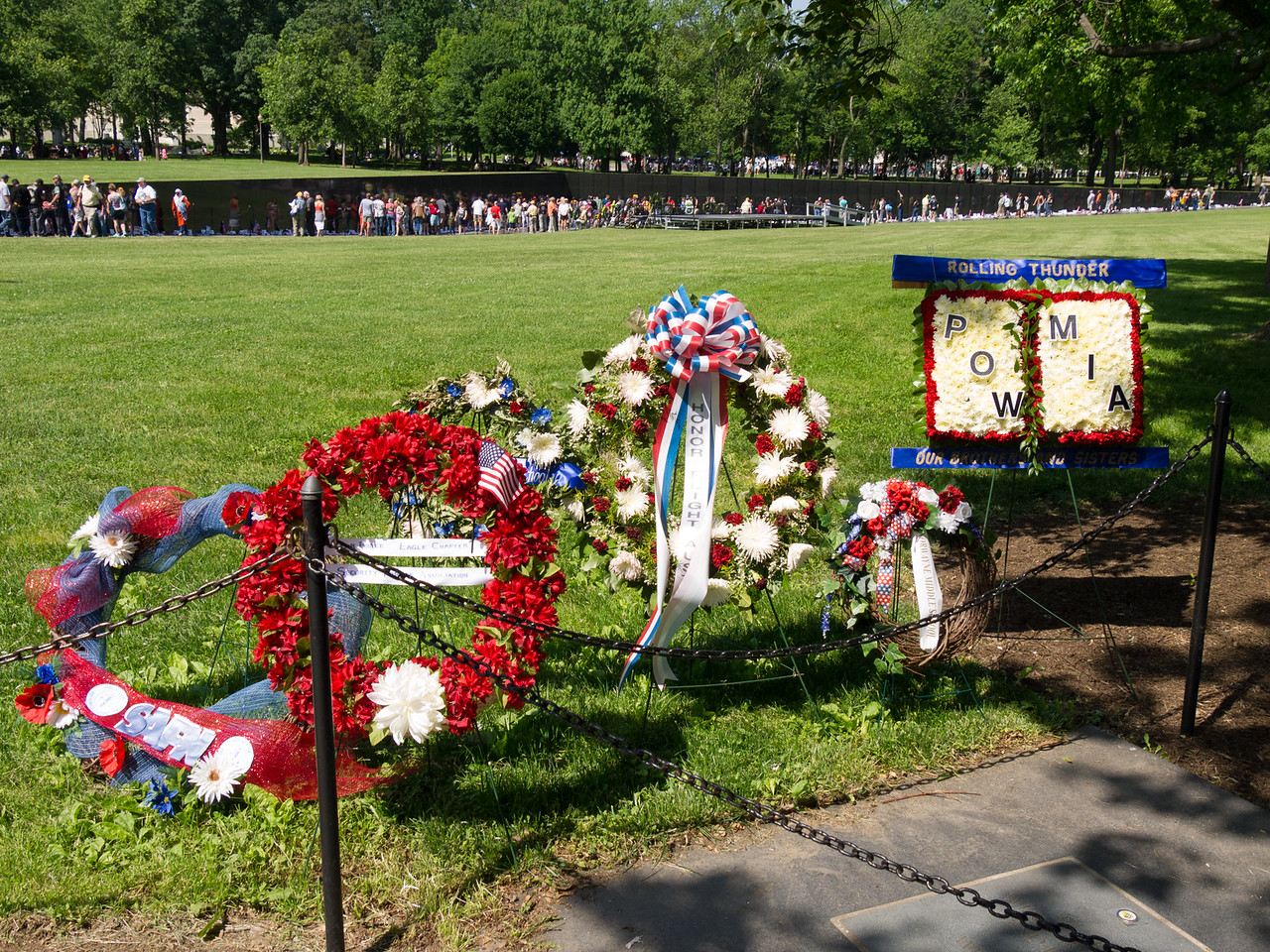 Wreathes near the three soldiers, looking toward the Vietnam memorial wall