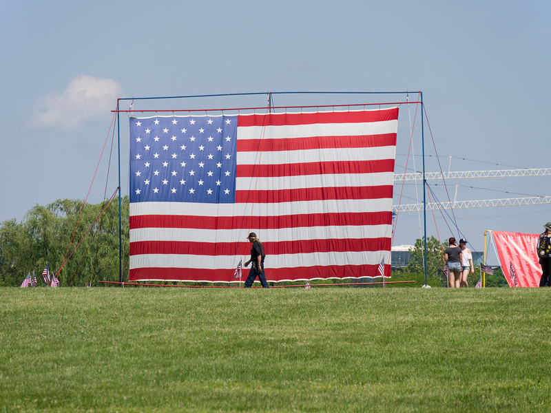 Large American flag - and a Rolling Thunder participant