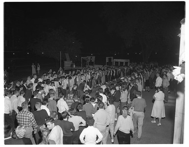 FRAT, SORO and PANA - Students participate in a tricycle race during Greek Week on Oct  30, 1959