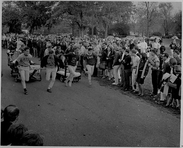 CAMPUS LIFE -FRAT, SORO, NPHC - Alpha Tau Omega and Sigma Phi Epsilon members compete in the bed race during Greek Games on Oct  22, 1966