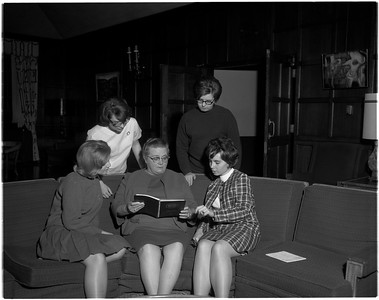 student organizations - Members of Indiana StateGC¦ºO¦ês Association of Childhood Education read together on a couch on Oct  27, 1966