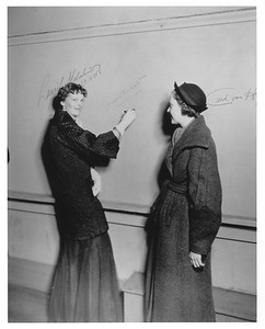 Signature Wall -  Amelia Earhart signs a wall in the theater while visiting campus  - Copy