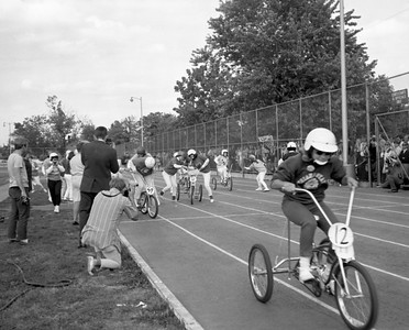 trike - Students compete in the Trike Derby on the athletic practice field and track, now Marks Field, during Homecoming week in 1968