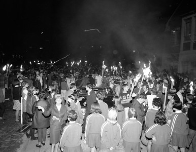 HOMECOMING -Students participate in a torchlight parade during Homecoming celebrations in 1968