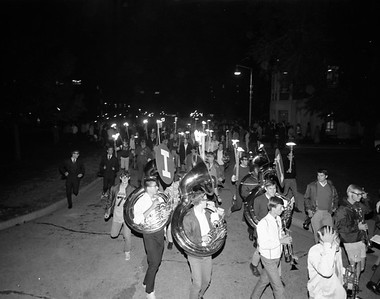 torchlight parade - The marching band and students participate in a torchlight parade during Homecoming celebrations in 1968
