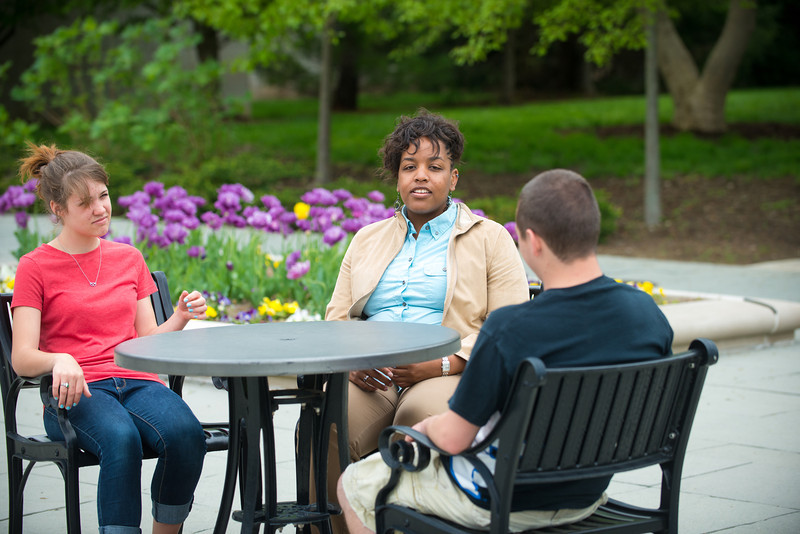 Students visiting with faculty member