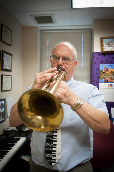 Photos of Tom Johnson in his office for Alumni Magazine