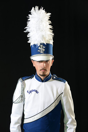 Marching band member in studio with saxophone