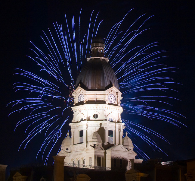 Fireworks explode over the Vigo County Courthouse in Terre Haute, Indiana, during the annual Fourth of July fireworks display