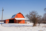 A red barn following a snow and ice storm in Illinois