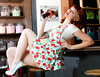This image was published in The Cats Meow Feb. 2015 issue. Aprons provided by Doll Me Up Darling, Model Miss Tracy Anne, Location Five And Dime Candy Store fascinators by backhousegifts.com