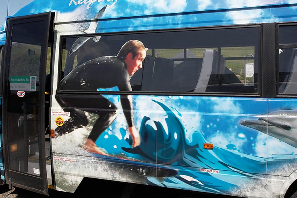 One of a total of fifteen photos featured on local tourist buses.