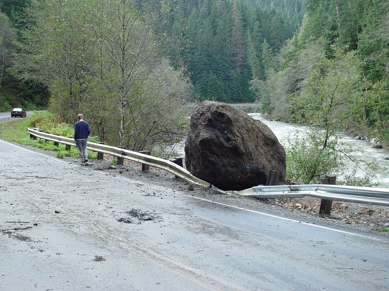 The guard rail stopped this rock from going into the river.