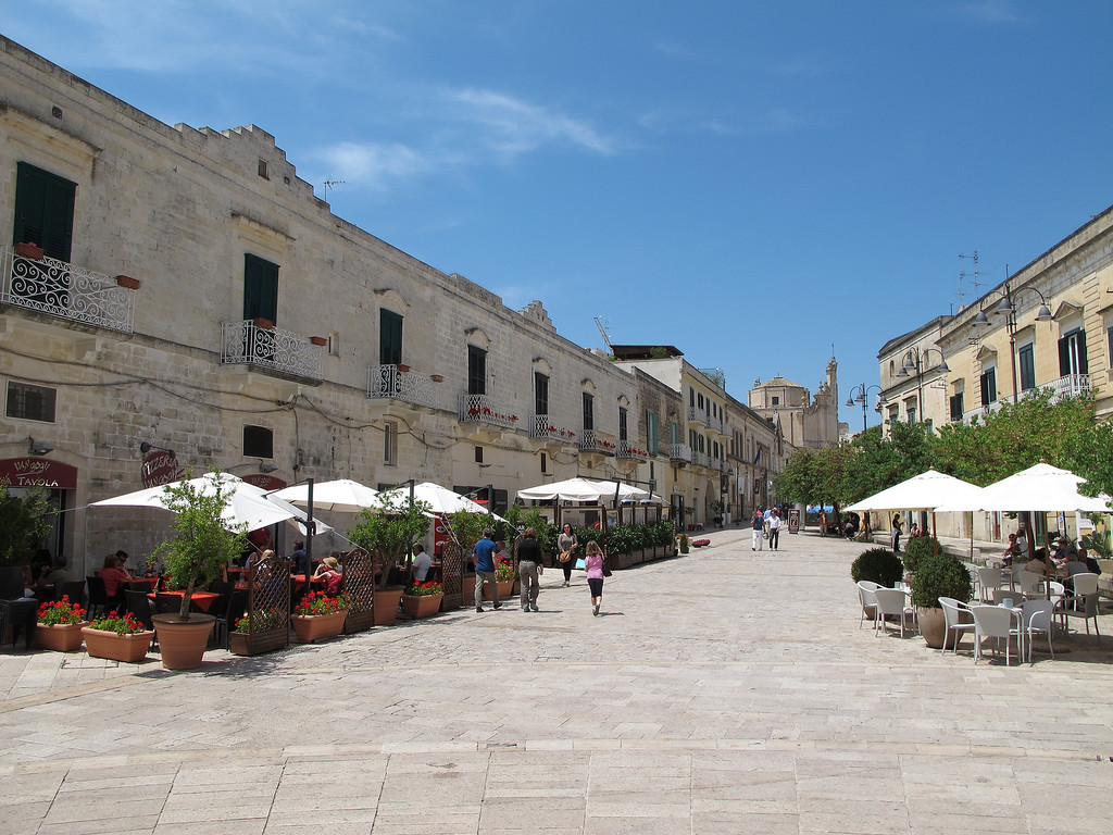 The view from the shady steps to a church in Trani